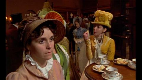 Film still from 1995 adaptation of Persuasion showing Elizabeth eating sweets.